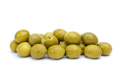 Some green olives with pits. Isolated on the white background stock images