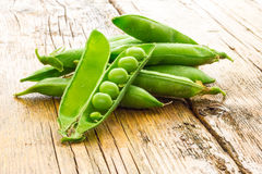 Some green peas. On the table Stock Images
