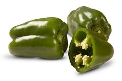 Some green peppers over a white background. Stock Photos
