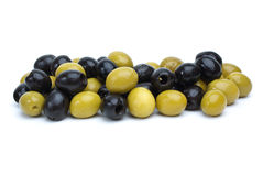 Some green with pit and black pitted olives. Isolated on the white background stock images