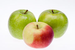 Some green and red apples isolated on white background Stock Photos