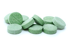 Some green tablets. Isolated on the white background Stock Photo
