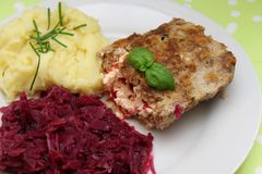 Salmon fish with red cabbage. Some grilled salmon fish with red cabbage and potatoes stock photos