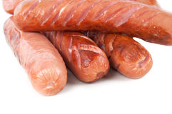 Some grilled sausages. Grilled sausages on a white background Royalty Free Stock Photo
