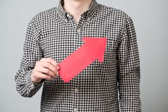 Young man with red arrow Stock Images