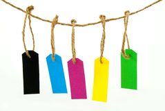 Some hanging maker tags. Some hanging marker tags in different colors, on white stock image