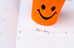 Some happy icon on the calender with vacation text Stock Image
