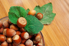 Some hazelnuts in plate. With leaves Royalty Free Stock Image
