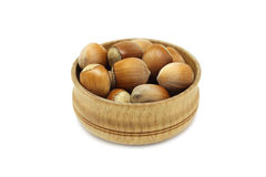 Some hazelnuts in a wooden bowl. On a white background Stock Image