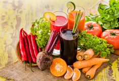 Some healthy fresh juice with ingredients. Portrait of some healthy fresh juice with ingredients Stock Image