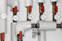 Some heating pipes. With valves and manometers royalty free stock photography