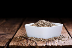 Some Hemp Seeds. (close-up shot) on wooden background royalty free stock images