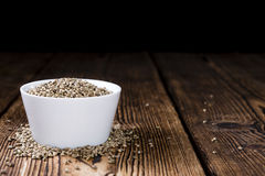 Some Hemp Seeds. (close-up shot) on wooden background royalty free stock photo