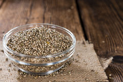 Some Hemp Seeds. (close-up shot) on wooden background royalty free stock photography
