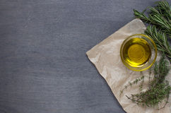 Some herb and olive oil. On wooden background. Top view Stock Photos