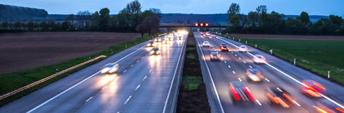 Some highway traffic in the evening. Some plain highway traffic in the evening Royalty Free Stock Photos