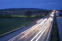 Some highway traffic in the evening. Some plain highway traffic in the evening Stock Photo
