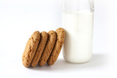 Some homemade cookies. Several homemade cookies with a bottle of milk on a white background Royalty Free Stock Photos