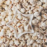 Some homemade Popcorn as detailed close-up shot, star shaped bowl, top view. Instagram matte filter. Some homemade Popcorn as detailed close-up shot, star royalty free stock photography
