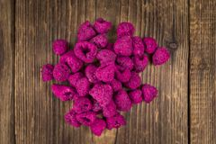 Portion of Raspberries dried, selective focus Stock Images