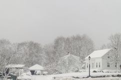 A snow storm picture. Some houses and cars cover with snow Royalty Free Stock Image