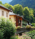 Some houses in the forest. Village in french Alps named Beaufort on Doron stock photo