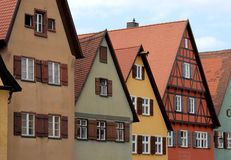 Some houses of varying colors and windows with white windows in the town of Dinkelsbuhl in Germany. Photo made to houses in a street of the town of Dinkelsbuhl Royalty Free Stock Images