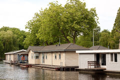 Some houses by the water. Some wooden houses by the water stock photography