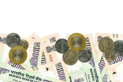 Some 100 indian rupee bank notes and coins. With copy space royalty free stock image
