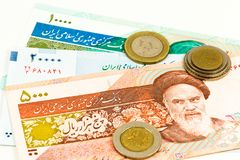Some iranian rial bank notes and coins. With copy space stock photography