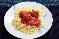 Pasta with meatballs. Some italian pasta with a sauce of tomatoes and meatballs Royalty Free Stock Image