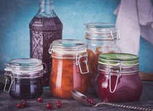 Some jars of homemade jam. Fresh some jars of homemade jam on rustic table. Toned Stock Images