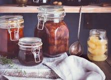 Homemade jam closeup. Some jars of homemade jam on table, closeup. Toned royalty free stock image