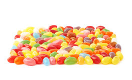 Some jelly bean sweets forming a square shape. Isolated over the white background, shallow depth of field side view foreshortening Stock Photography