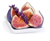 Some juicy, ripe of  fig and basil flower. Some juicy, ripe slices of  fig and basil flower on white background Royalty Free Stock Images