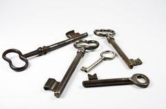 Some keys. Old-fashioned keys on white Stock Images