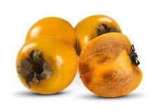 Some khaki fruits on white background. Royalty Free Stock Image