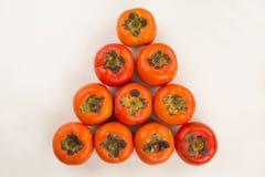 Some khaki fruits on white background Royalty Free Stock Photos