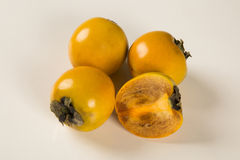 Some khaki fruits on white background Royalty Free Stock Image