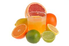 Some kind of citrus with the glass filled with citrus juice isol Royalty Free Stock Image