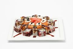 Some kind of sushi on white plate. Isolated on white background Royalty Free Stock Photo