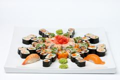 Some kind of sushi on white plate. Isolated on white background Stock Images