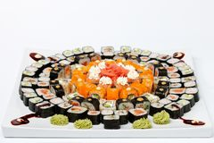 Some kind of sushi on white plate. Isolated on white background Royalty Free Stock Images