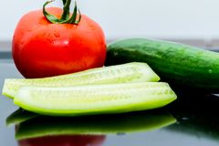 Some kind of vegetables on the table. Some kind of vegetables on the kitchen table ready for making salat Stock Images