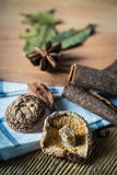 Some kinds of spice. Amomum tsao-ko,dried mushroom and cinnamon on wood plank Royalty Free Stock Photos