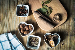 Some kinds of spice. Amomum tsao-ko,dried mushroom,pepper,anise and cinnamon on wood plank Royalty Free Stock Photography