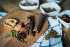 Some kinds of spice. Amomum tsao-ko,dried mushroom,pepper,anise and cinnamon on wood plank Royalty Free Stock Images