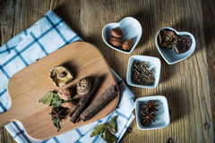 Some kinds of spice. Amomum tsao-ko,dried mushroom,pepper,anise and cinnamon on wood plank Royalty Free Stock Photos