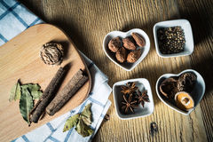 Some kinds of spice. Amomum tsao-ko,dried mushroom,pepper,anise and cinnamon on wood plank Royalty Free Stock Image