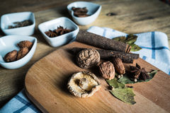 Some kinds of spice. Amomum tsao-ko,dried mushroom,pepper,anise and cinnamon on wood plank Stock Photography